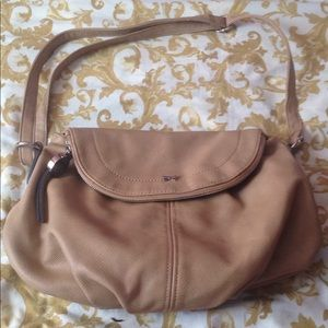 Cute tan bag used a few times. No stains,no marks